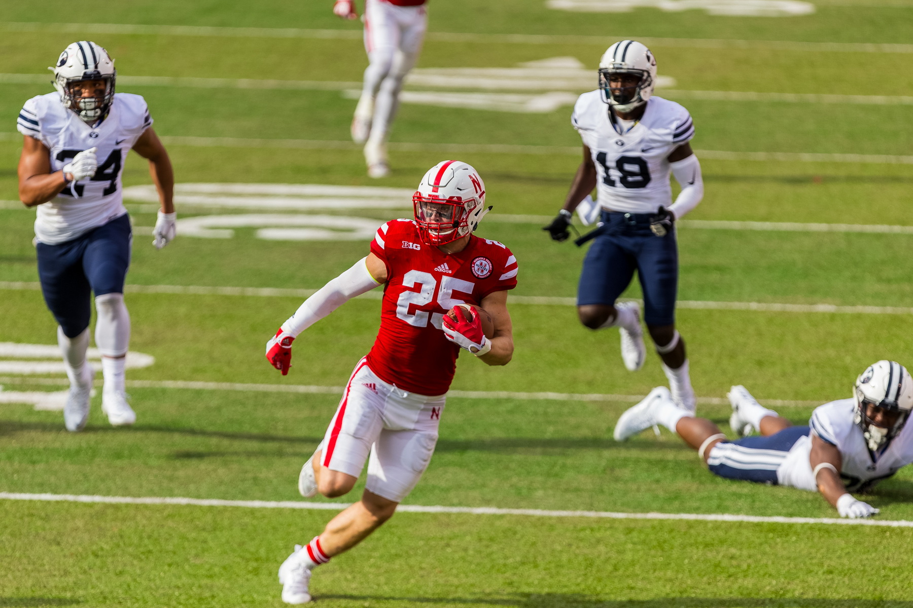 Nate Gerry #25 of the Nebraska Cornhuskers returns an interception in the second half of Nebraska's 33-28 loss to BYU on Sept. 5, 2015. Photo by Aaron Babcock