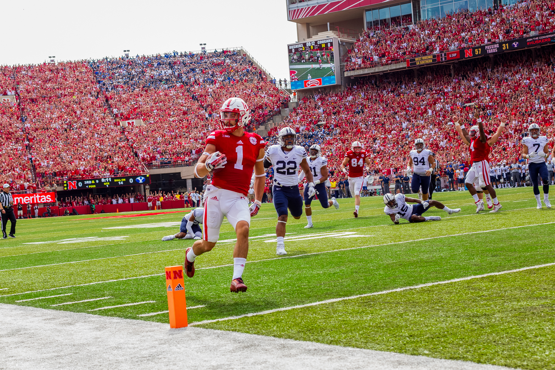 Jordan Westerkamp #1 of the Nebraska Cornhuskers breaks a tackle to score a touchdown in the first quarter of Nebraska's 33-28 loss to BYU on Sept. 5, 2015. Photo by Aaron Babcock