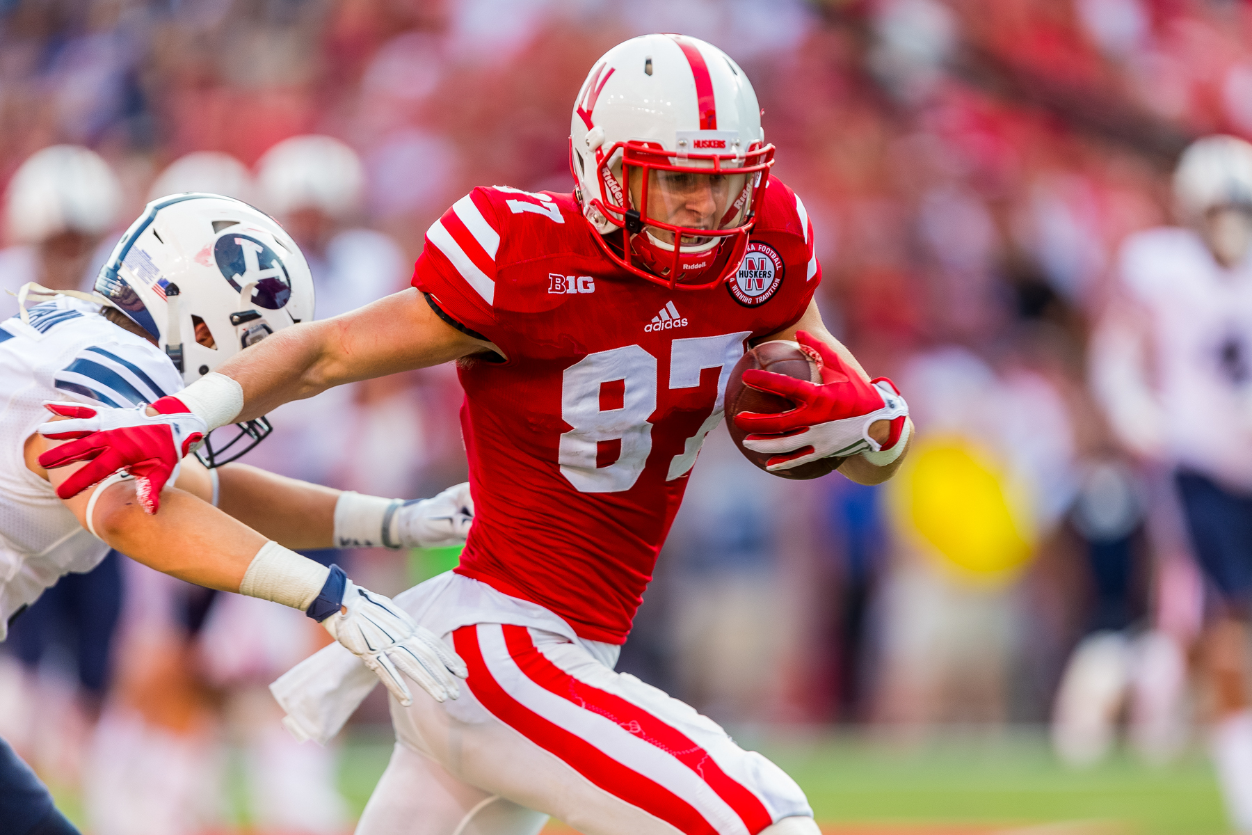Brandon Reilly #87 of the Nebraska Cornhuskers races down the field after his fourth quarter catch during Nebraska's 33-28 loss to BYU on Sept. 5, 2015. Photo by Aaron Babcock