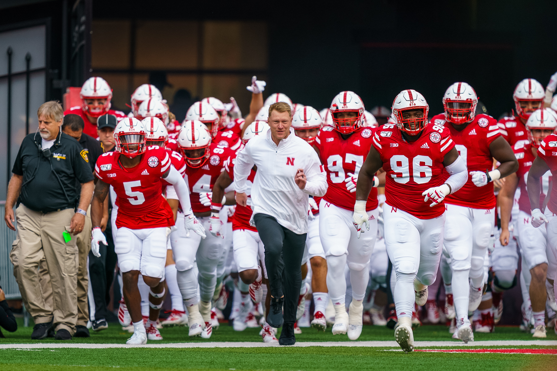 Scott Frost leads the team out prior to Nebraska's 35-21 win over South Alabama at Memorial Stadium in Lincoln, Nebraska on Aug. 31, 2019.   © Aaron Babcock
