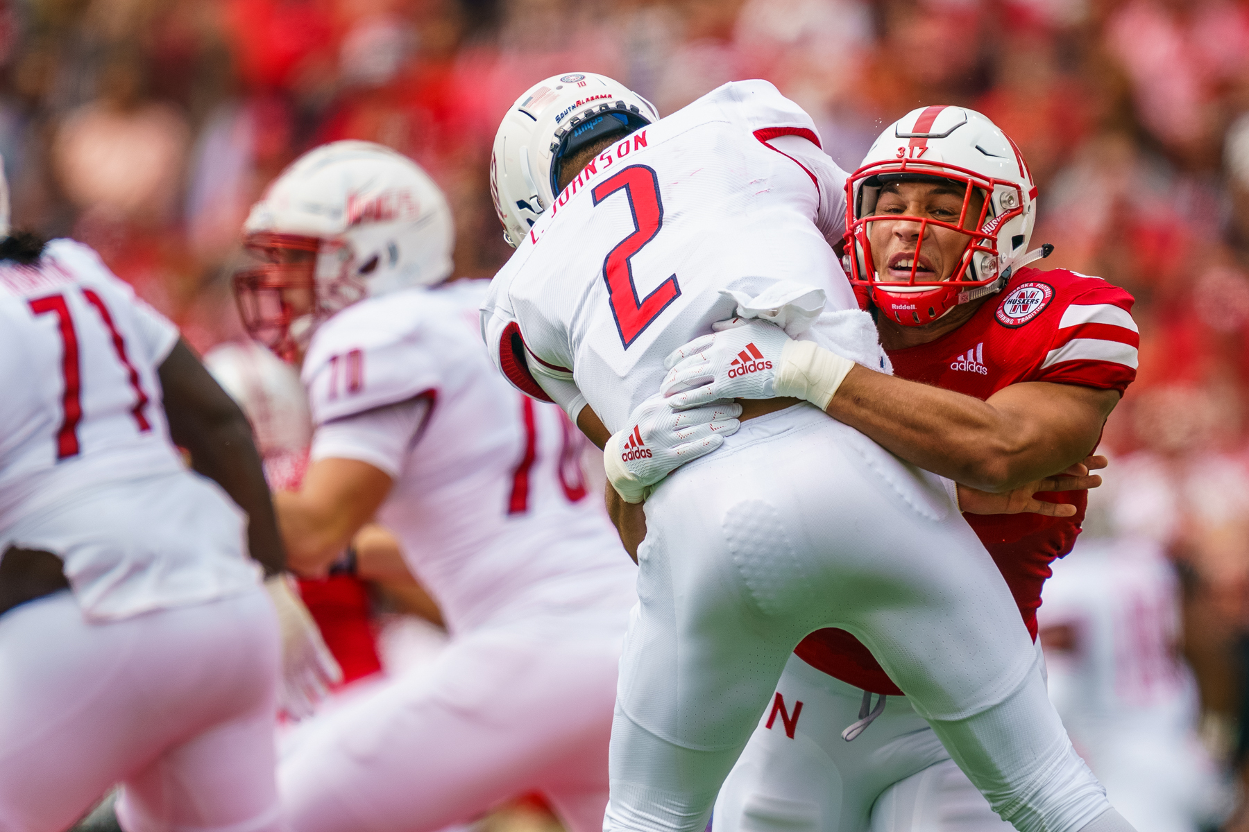 Collin Miller #31 of the Nebraska Cornhuskers pressures Cephus Johnson #2 of the South Alabama Jaguars during Nebraska's 35-21 win over South Alabama at Memorial Stadium in Lincoln, Nebraska on Aug. 31, 2019.   © Aaron Babcock