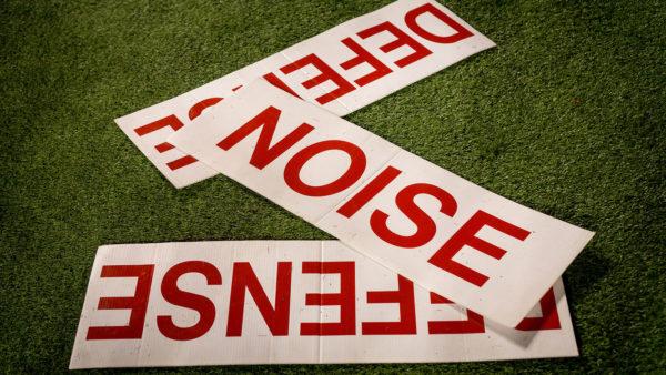 football cheerleading signs on the turf
